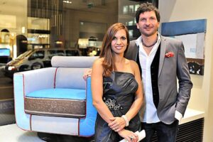 Artist Joseph Pisani with Anna Maier and his painted Natuzzi Chair